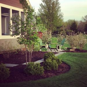 landscape with a patio, Japanese Lilac, and Korean Spice Viburnums