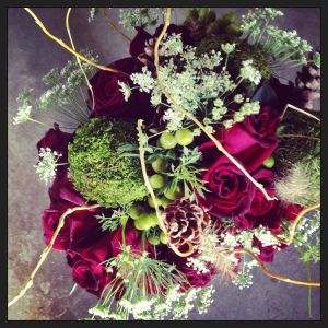 burgundy roses, green, and white floral bouquet