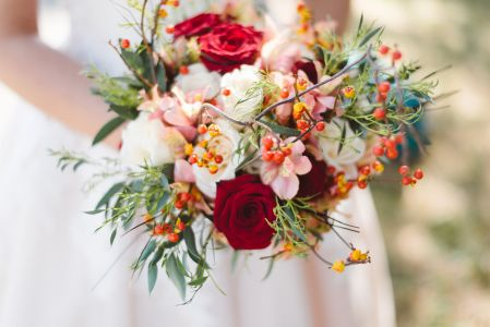red roses, green, pink and white floral bouquet