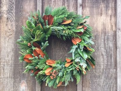 Magnolia and evergreens holiday wreath