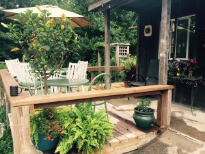 small wooden deck with patio furniture