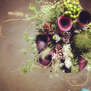 Purple and green bouquet with pinecones