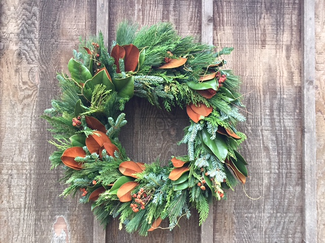 wreath with magnolia leaves, cedars, firs, pines, twigs and rose hips