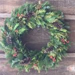 fresh greens and pinecones wreath
