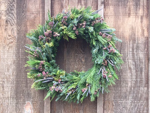 a round wreath with a mix of lavender and oregano