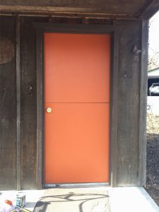 Wooden shed with orange door