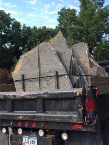 truck holding flagstone