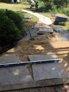 pathway in the process of being built with flagstone