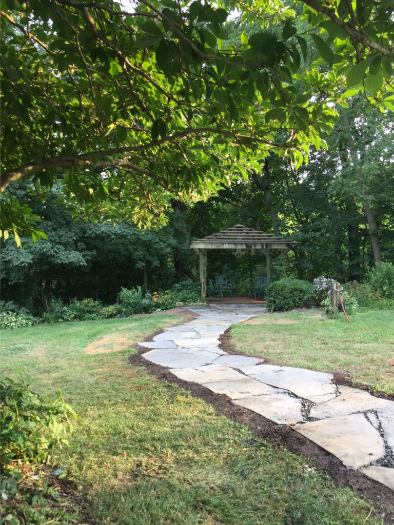 flagstone pathway leading to pergola