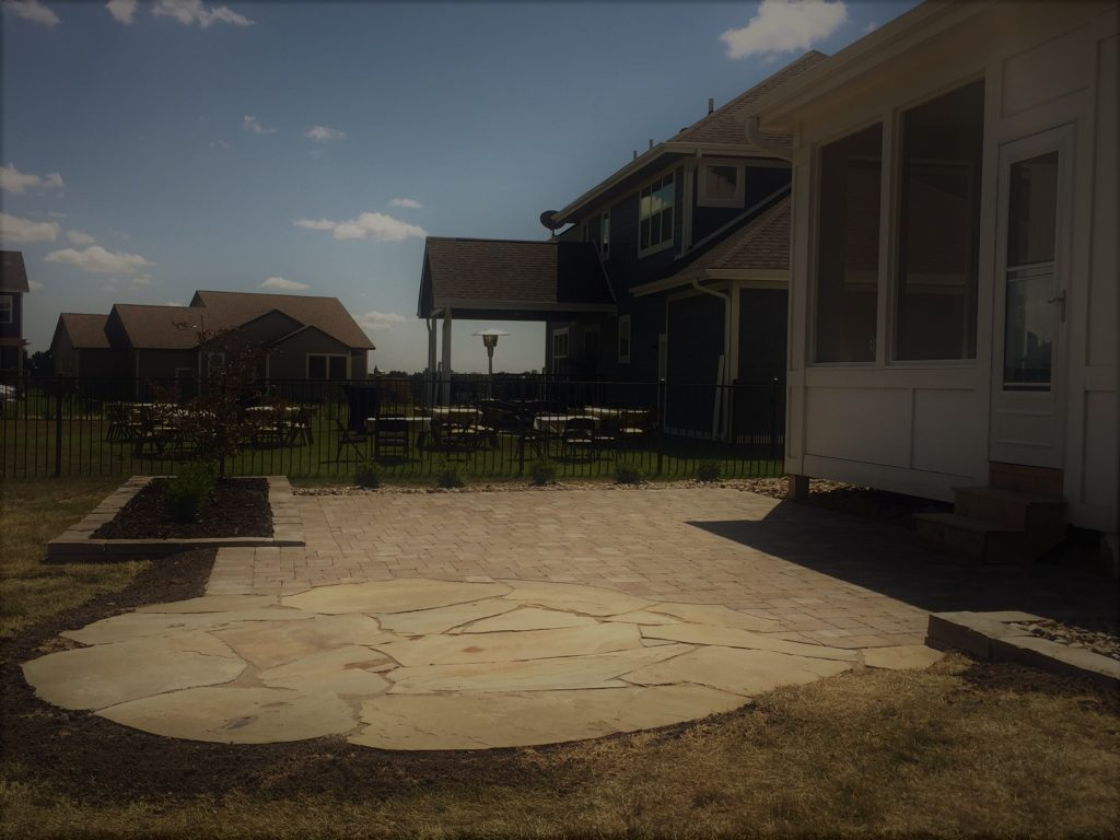 Finished patio with pavers and flagstone